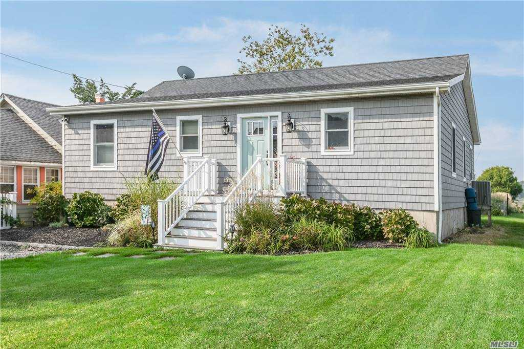 Move right in to this delightful 4 bedroom/2 bathroom home located in a beach community with deeded beach rights. Views of Meeting House Creek from backyard. Close proximity to the bay, restaurant and marina. Entire house rebuilt in 2015.  Wonderful weekend get away or a year round residence.  All one level. Open concept living space. Sliders to back deck and patio to enjoy the sunsets. Low maintenance property.  Close to all the North Fork has to offer.