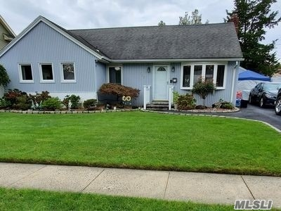 Beautiful 4 bedroom, 2 bath expanded ranch in the Barnum Woods section of East Meadow. Updates include HUGE family room. 2 year young granite kitchen, banquet sized dining room. wood floors throughout, brand new compressor,  and finished basement w/full bath. Backyard is all paved and fenced in and garage is perfect for working (or hiding)  at home complete with electric, heat and air conditioning. Taxes are shown without basic STAR of $1197.83