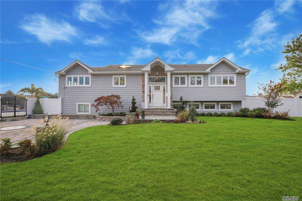 "Looking For That ""WOW"" Factor? Well...Here it is! This Spectacular South Shore Waterfront Home Has it All!! Redone in 2018, Featuring 4 Bedrooms, 2 1/2 Baths, inc. Master En-Suite, Eat-in Kitchen with Quartz Countertops and GE Cafe Stainless Steel Appliances, Formal Dining Room, Living Room w/Wood-Burning Fireplace, Den w/Fireplace, 16x30 Saltwater-Heated In-Ground Pool surrounded by Designer Pavers, a Tucked Away Beach Area, Additional Room for a Playground, 85""ft., of Bulkhead and the list goes....on! Convenient to Fire Island, Montauk, and Manhattan!! West Islip Award Winning Blue Ribbon School District. Just Pack Your Bags!!"