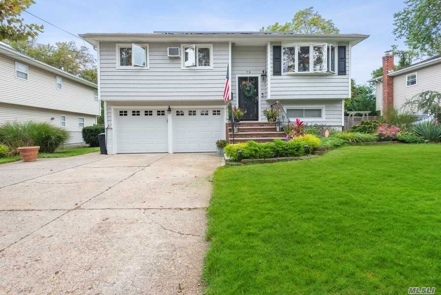 Beautiful Updated Hi Ranch in the Village! Enjoy the open kitchen which features high end SS appliances, granite counters w/island, dining room, living room. Hardwood floors throughout. 4 bedrooms or 3 bdrms and a home office, den & 2 baths. Enjoy dining on the deck or walkout to the parklike grounds. Updated Heating System, roof and solar panels for extra savings.