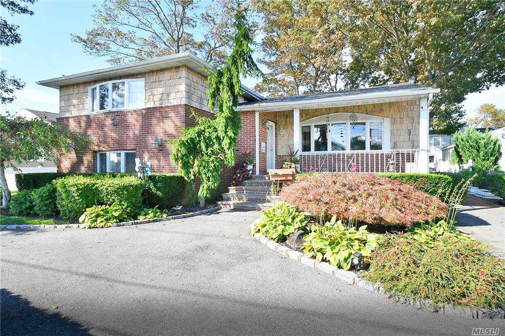 Spacious Expanded 4 Bedroom 3 Bath Side To Side Split In The Heart Of Massapequa Park. Open Concept Kitchen Living Room/Dining Room. Hardwood Floors Through Out. Beautiful 1100 Sq foot Great Room W/ Vaulted Ceilings, Skylights, Gas Fireplace, & Full Bath. SGD To Yard/Deck. Additional Lower Level Family Room Bedroom, Play Room Skylights and Full Bath.Separate  Entrance To Side Yard. IGS  Gas Cooking & Gas Dryer New Roof, Updated Heating System. Perfect For Extended Family Two lots for a total of 80x100. Pool Is A Gift. Taxes w/ Star $16,132.27