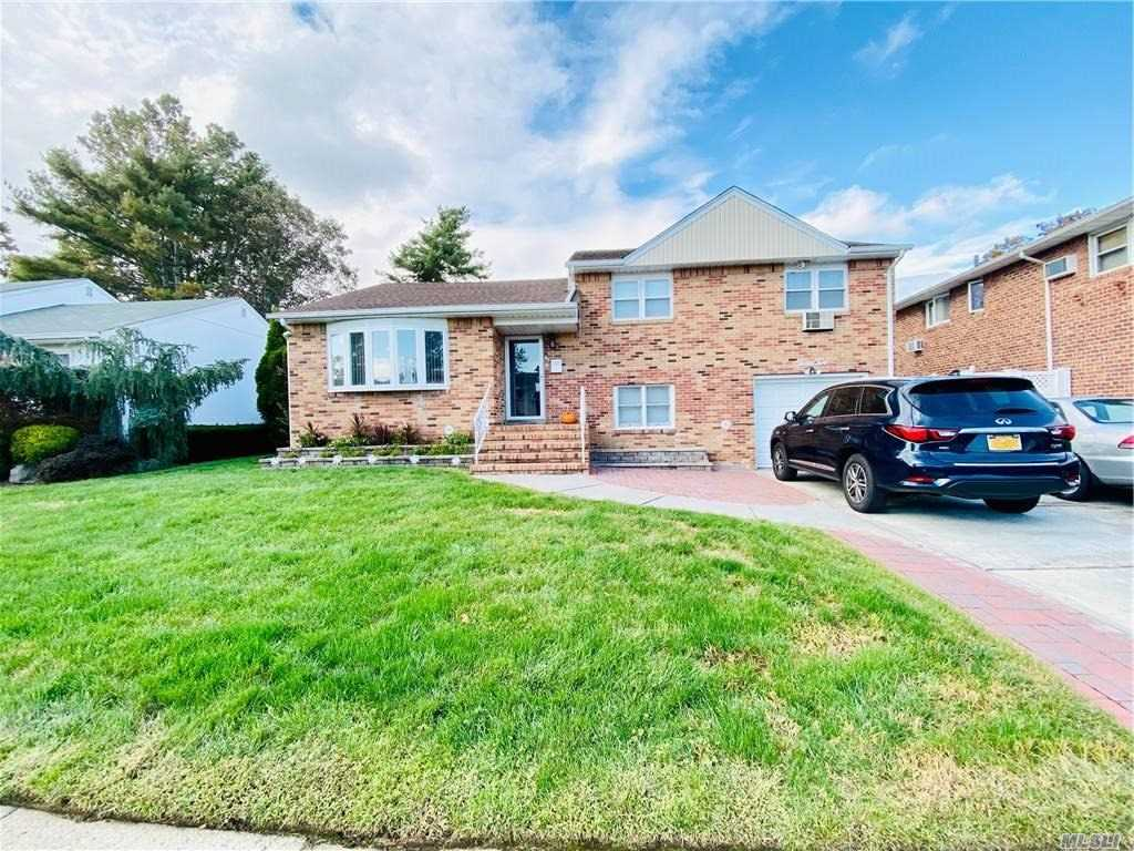 Feel like you are on vacation while at home! A perfect Long Island paradise meticulously maintained and updated Brick Expanded Split in Westbrook Park section of East Meadow School District.This home boasts high entertaining value on a low maintenance property. INTERIOR: 3 Bedrooms, 2.5 Baths, w/Full En-Suite Bath & Walk-in Closet in Master. Large Living Room, Formal Dining Room, Large Family/Great Room with Vaulted Beam Ceiling & Fire Place, Open Granite Kitchen, Hardwood Floors, Office/Den can serve as 4th Bedroom with its Own Entrance, Lots of Closets & Storage, Central A/C, Alarm System. EXTERIOR: Entertaining Deck with String Lighting for those perfect nights, Heated In-ground Pool with Gas Heater, Large Patio with Fire-Pit Enclosed by Warm In-Built Wood and Stone Benches, Garden Pergola with Bench, In-Ground Sprinklers, Multi-car Driveway. Minutes from Large Public Park, Public Transport, Major Parkways, Golf Courses & Shopping. An Absolute Must See!