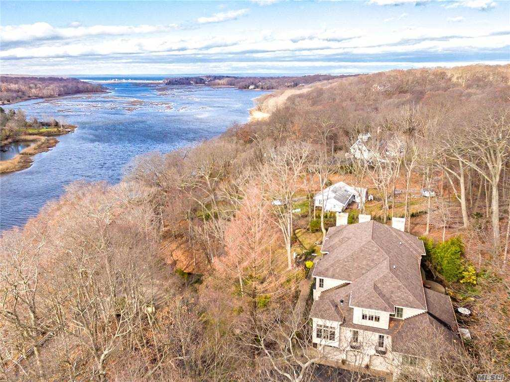 Stunning Waterfront Brick Manor Estate on 3.5 Acres of Property Overlooking Scenic Nissequogue River. 8500 Sq. Ft. of Elegance And Sophistication Exemplifies Perfection With The Use of The Finest Custom Millwork. Every Imagineable Amenity Including Indoor Gunite, Heated and Saltwater Pool, Elevator, Full Generator, Gourmet Kitchen, Theater on Main Level, Library, Gym, 2 Mater Suites, Outdoor Kitchen, Cherry Brazilian Floors, Finished Basement, Guest Quarters, 3 Car Garage, Large Principle Rooms And So Much More. A Must See!