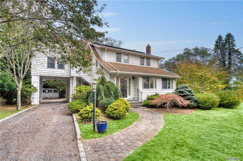 Remsenburg 4 bedroom charmer so convenient to a Moriches Bay sandy beach at end of street. En-suite master bedroom, plus 3 additional bedrooms. Den perfect for study or home office. Kitchen opens to dining room & living room with wood burning fireplace. Spacious enclosed porch sunroom overlooking private backyard garden. Detached garage plus a porte cochere. Room for a pool on this lovely well located half acre property.