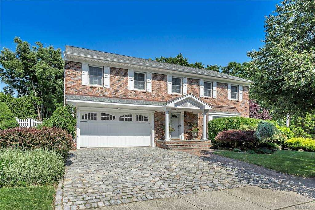 North Syosset - Diamond 4 bedroom, 2.5 bath Colonial set in Cul de Sac. Beautiful curb appeal. Professionally landscaped and fenced property. Oversized rooms, large entry. Gas heat/cooking. EIK with breakfast area surrounded by walls of windows. The house shows light and bright. Gleaming hardwood floors, CAC, IGS, 2 car garage plus so much more. Master bedroom has private bathroom and large walk in closet. Too many updates to list. Syosset Schools. This one is for you.