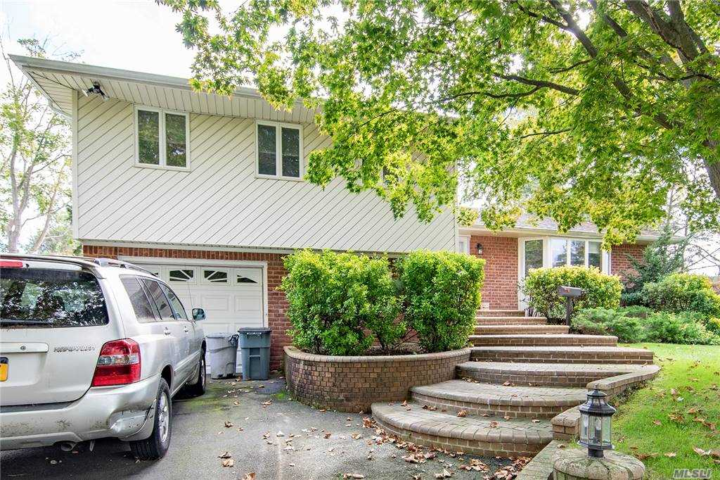 Well Maintained Split Level Home in the Sought out Triangle Section of Melville! 4 Bedrooms, 2.5 baths, Eat in Kitchen, Gas Cooking and Heat, Formal Dining Rm, Living Rm, Master Bedroom with Full Bath and 2 Big Closets, Spacious Den, 4th Bedroom on Lower Level, Finished Basement with Laundry, One Car Garage with Expanded Driveway, Beautifully Landcaped and Fenced in Backyard, Attic Storage, 3 Zone Heat, Inground Sprinklers, and More! Won't Last!