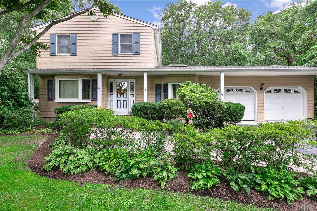 Expanded Colonial On Shy Half Acre  with Perennial Gardens and Flowering Shrubs. The Home Is  Much Larger Than It Appears From the Street Because of  Large Family Room Addition with Gas Fireplace.  Home Features Wood Flooring, Spacious Eat In Kitchen, Finished Basement, New Roof, Updated Siding, and Two Car Garage. The Rear Yard Is Perfectly Sited with Stamped Concrete Patio Off Rear Of House and Above Ground Pool with Deck Further Back. Plenty Of Lush Green Lawn for Recreation. Ideal For Small Gatherings Or Gracious Entertaining. Smithtown Schools.