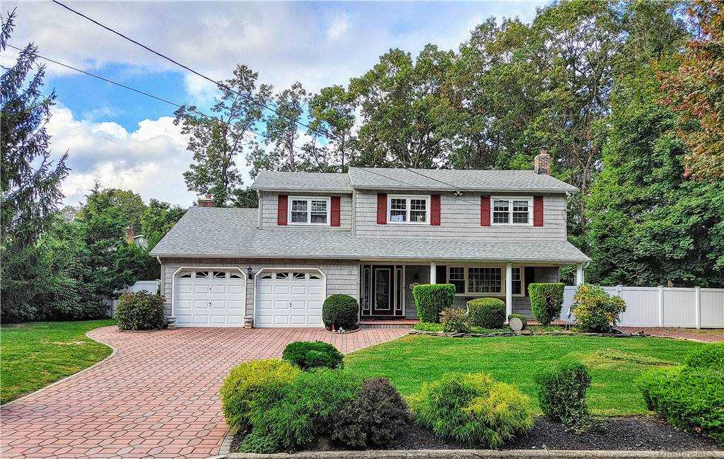 Nothing to do but unpack at this stunning 4 Bed, 2.5 Baths, fully updated spacious Colonial located on a private tree-lined block with a front porch to relax on!! TAXES Before STAR-$11,955.92. Master Bedroom has Full Bath w/ Walk-In Closet,  Gleaming Hardwood Floors Throughout, Granite Kitchen with SS Appliances and bonus custom shiplap counter top for cooking/entertaining, Wood Burning Fireplace in Den/Family Room with Sliding Doors to Patio/Backyard, CAC, Gas Heat, IG Sprinklers, Full Basement with new Washer/Dryer, 200 Amps Elec, Brand New Resort Style Salt Water In-Ground Pool and new filter system with surrounding brick work. Views of the backyard/pool can be seen from every window in back of house.  CO's for everything!! Minutes from Shopping/LIRR/All Highways. Desirable Shoreham-Wading River Schools.