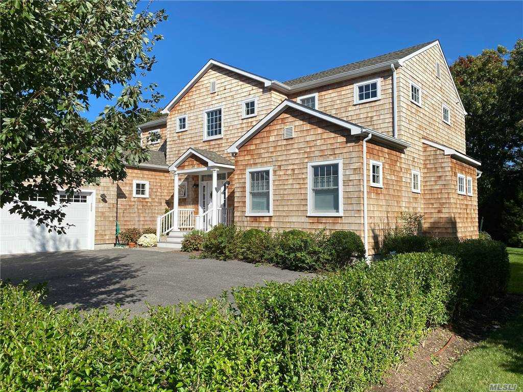 Enjoy condominium living in Jessups Landing! This single-family home is move-in ready. Enjoy the first-floor open spaces, large living room, master bedroom suite, airy sunroom, library, dining room and open kitchen with Energy Star stainless steel appliances, the second floor has two large bedrooms, two baths and a lounge area that could easy serve as a third second floor bedroom. The lower lever also has two bedrooms and a lounge with built in bookcases. With economic natural gas heating, low taxes and a low maintenance fee, Jessups landing is a home run for low cost living in Quogue. This is a quite community with a community pool and mature landscaping with easy access to the Village of Quogue, the Village beach, and the Jitney bus stop.