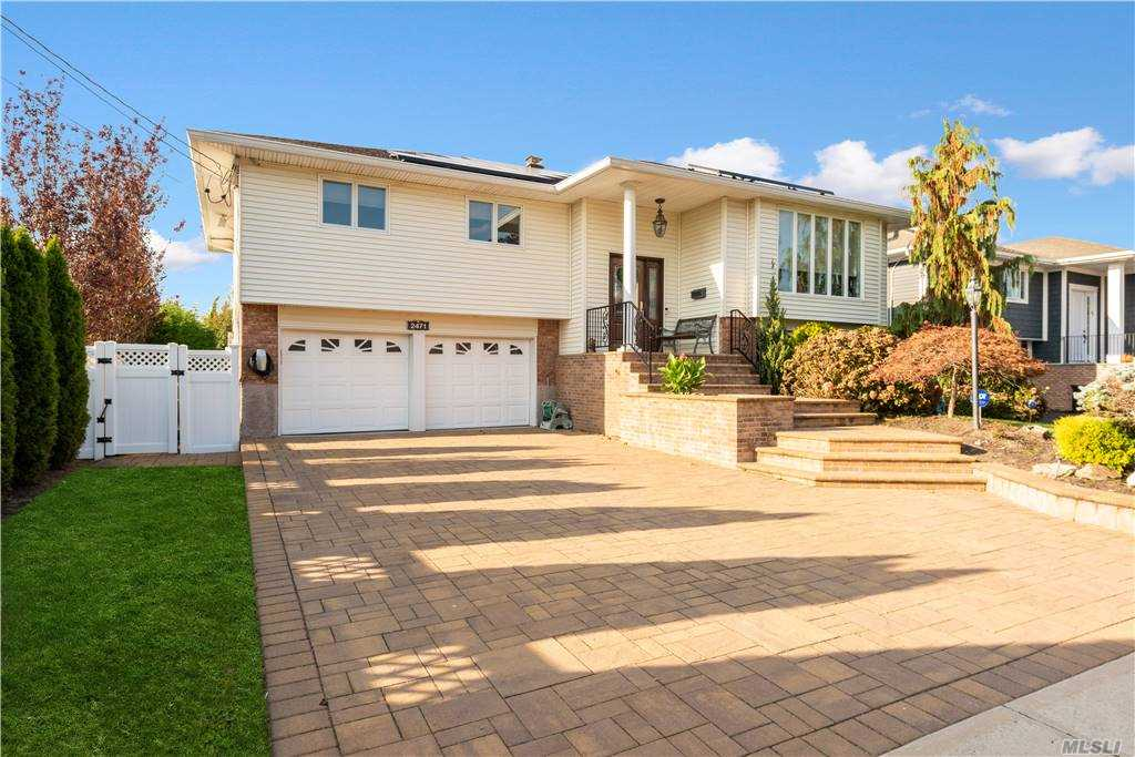 Nothing Left Untouched in this Custom Design, Updated Home Located in a Desirable Neighborhood. Open Concept. Entertainment Area with Fireplace and Custom Wood Working, Dining Room, and an Amazing Kitchen with Energy-Efficient SS Appliances with Double Ovens. Custom Double Pantry and Plenty of Room for Storage and Cooking. Master Suite and Wood Floors Throughout. First Floor Updates Have as Much Thought and Attention to Detail as to the Main Floor. Spacious Bedroom or Family Space, Office, Roomy Storage. Very Large Laundry Room & Entrance to Garage. Amazing Outdoor Space w/Carefully Thought out Design for Entertaining. Separate Area w/Pool. Beautiful Landscape & IGS. This Home has Solar Roof panels w/Tesla Power Walls & Tesla Car Charging Stations. No Paying for Electricity! Low Taxes!  This Incredible Home Can Be Yours!