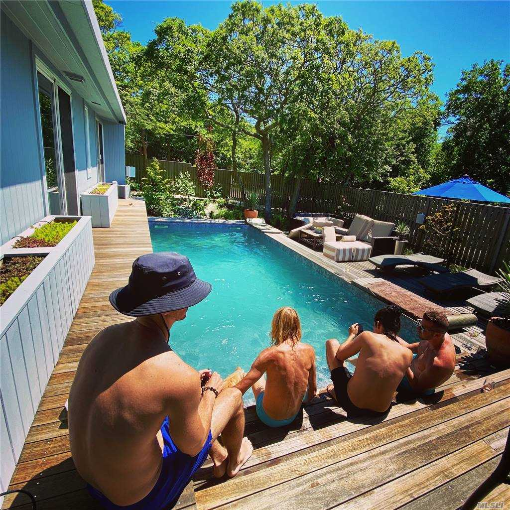 Welcome to the stylish side of Beach living! Step through the gates into this beautifully manicured garden and breath a sign of relief! The stunning landscaping welcomes you home to this 3 bedroom, 2 bath immaculate home. The gorgeous natural wood floors present optimal living and entertaining space for you and your guests. The updated kitchen is ideal for any type of chef, and leads you to the generous deck space and salt water, heated pool. The private hot tub is situated within the gardens and secluded seating area with fire pit. As you head up the outdoor staircase to the roof deck, you will be completely at peace. The large roof deck offers additional entertaining and relaxing space. After you return from the beach, rinse off in the private outdoor shower. This home is complete with central air and heat, and is fully winterized to enjoy all year round! You don't see gems like these often, so schedule your private showing today!