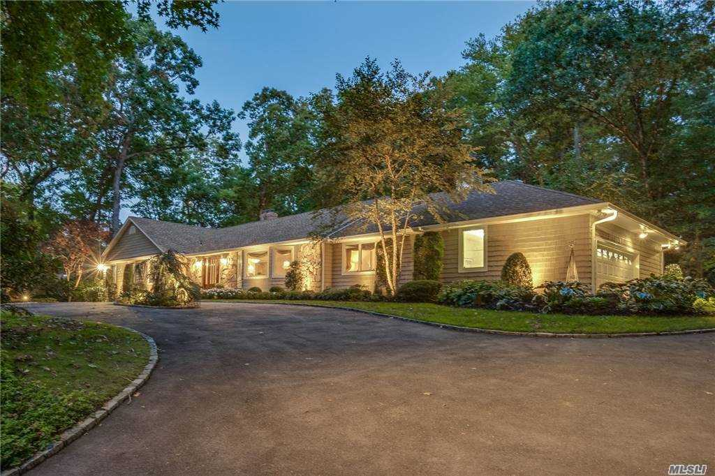 Welcome to The Hollows of Muttontown! This exceptionally kept Ranch sits on over 2 park-like acres and is updated throughout with today's modern amenities. Enjoy everyday gatherings in spacious eat-in kitchen with custom cabinetry, granite countertops, pantry, professional appliances, views of backyard, and convenient adjacent laundry. Large picturesque windows allow for a sun-filled interior with high ceilings. Family room with fireplace, vaulted ceiling, and glass sliders to patio. Master bedroom features a large walk-in closet with built-ins and en-suite featuring dual sinks, and radiant floor heat. Tranquil property with rear paver patio and mature plantings providing ample privacy. This secluded treelined community is only minutes to shopping, restaurants, golf courses and nature preserves, 2.5 miles to both Syosset train station and Oyster Bay Village, and 5 miles to the L.I.E/Northern State Pkwy. Full basement, and natural gas 25KW Generac whole house automatic generator.