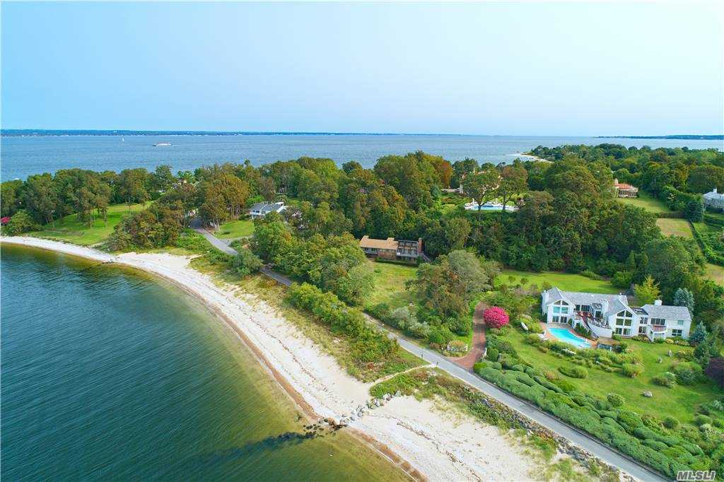 Best waterfront value in sands Point, 180 degree views of Manhattan. Enjoy beach living with magnificent sunset views! This contemporary residence consists of 2.1 acres of land and .58 acres of private beachfront, 4 bedrooms, 2.5 baths, open great room with walls of windows overlooking the water.