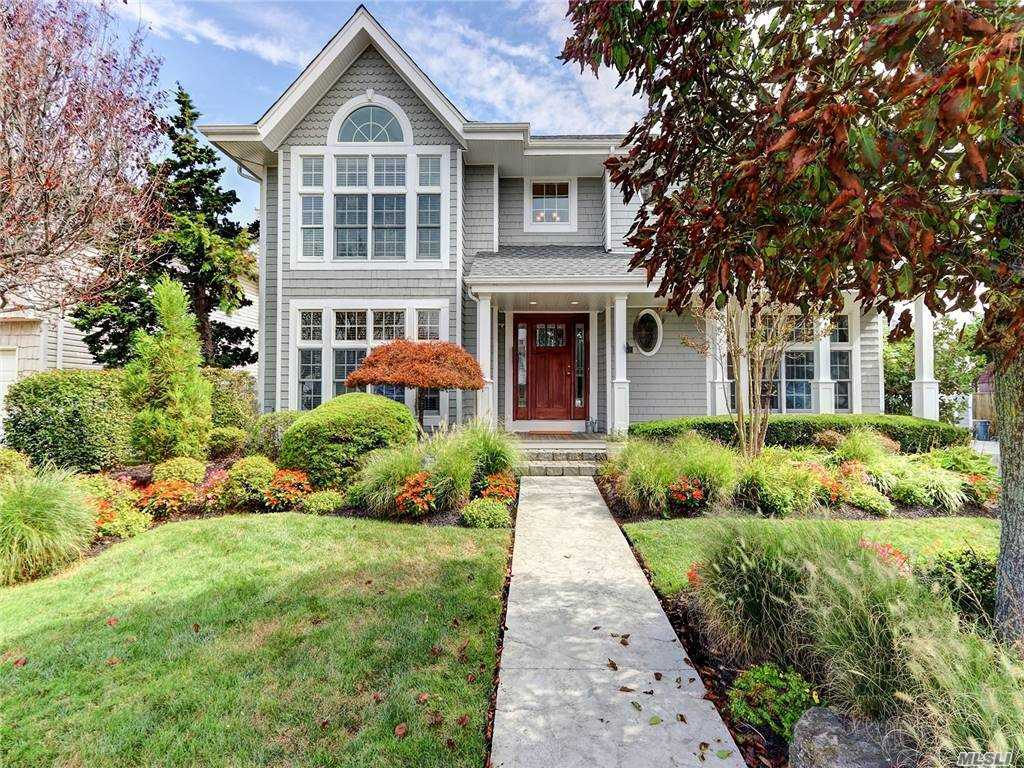 Magnificent, Custom Built Hidden Harbor Waterfront Colonial. Located In Cul De Sac, On Deep Water Canal, Seconds To The Bay w/ 105' Bulkhead & Floating Dock. Inground Heated Saltwater Pool w/ Stamped Concrete Patio & Electric Cover. Brand New Roof w/ Lifetime Warranty. Travertine Tile Floors & Oak Throughout. New Gourmet Eik w/ Concrete/Marble Counters, Custom Wood Cabinets, Wolf Double Oven & 5 Burner Stovetop, Subzero French Door Refrigerator, Reverse Osmosis Drinking Water. 2.5 New Baths. Mahogany Front Porch w/ Rear Wraparound Porch. Master Suite w/ Office Nook, 2 Walk In Closets & Bath w/ Standalone Soaking Tub, Water Closet, Double Vanity & Standup Shower. Whole House Water Filtration System. 2 Zone CAC. Detached 1.5 Car Garage w/ Ductless AC. Audio System w/ Speakers Throughout House & Security System. SEE Attached Highlight Sheet For More! One Of a Kind Home In Most Desirable Neighborhood In Seaford Schools.