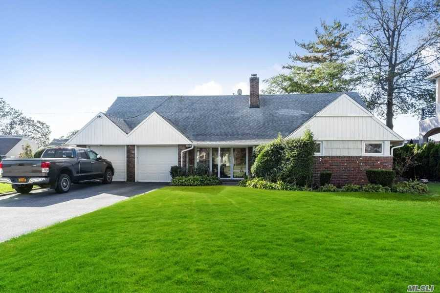 Welcome To Your Opportunity To Live In The Heart Of E. Rockaway!  Located In The Lynbrook School District! This Cape Cod Style Home Is A Corner Property Situated On A 89 x 119 Lot With a Two Car Garage.  It's Interior Features, 5 Bedrooms And 2.5 Baths With Expansive Interior Square Footage Of 2,163 And Central A/C.  The House Has An Open Concept Dining Room And Living Room That Has A Wood Burning Fireplace, Access To Your Backyard From The Family Room And A Master Bedroom With A Private Bathroom. The Second Floor Is A Blank Canvas That You Can Design With Infinite Possibilities, Such As Your New  Home Office, Bedrooms, And Additional Lounging Space.Flood Insurance 1366.