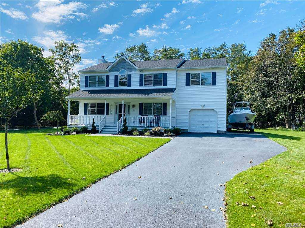 Diamond condition 4 bedroom 2.5 bath colonial style home in prime location! Do not miss out on this move in ready home with beautiful wood floors, open floor plan, vaulted ceilings, skylights, formal dining room, large master suite with bath and 2 walk in closets, custom kitchen with white cabinets and granite counter, 2.5 custom baths and more! The property is located in a prime area south of Montauk Highway, is level, private and would easily accommodate a pool and more. There is an attached 1 car garage and a full basement. Must See! No work is needed here, just move your belongings in and enjoy!
