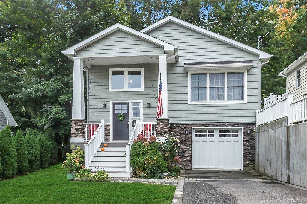 Dazzling & Dramatic!!  If you like open and airy living, you'll adore this stunning 6 year young home offering 4 bedrooms, 2.5 baths, Living Room, Dining Room, Gourmet Kitchen, Master Bedroom with walk in closet and master bath, separate laundry room, Gleaming Hardwood Floors, CAC, Attached Garage, Deck, Private fenced yard.  Walk to all!!