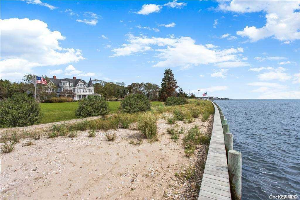 Extraordinary Bayfront opportunity with this last of its kind, Majestic 3 Level Victorian. Perfectly positioned on 3.5 pristine Bayfront acres offering endless views of Moriches Bay, this Victorian is steeped in both history and European Inspired design and is truly one of the last great LI Estates remaining on the south shore of Long Island. Boasting 9000 sqft of luxurious living space easily distributed across 3 levels built from the finest European Craftsman using only the finest woods. The interiors boast impressively scaled rooms and endless details that feature 7 fireplaces ,high ceilings, floor to ceiling windows, and private balconies offering daily breathtaking Bay views. Additional exterior amenities include the oversized sunsoaked 44ft long Pool, floral gardens, and the spacious wrap around porch which overlooks 472 feet of waterfront inviting Boat lovers and watersport enthusiasts of all ages to come explore the wide open waters of Moriches Bay.
