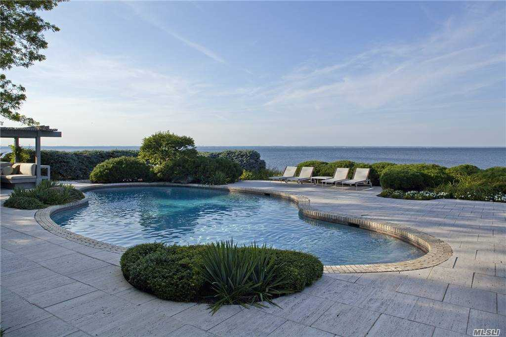 Unparalleled waterfront location on 2.13 acres at the end of a Cul de Sac, this beautiful modern ranch with 300 feet of private beach offers privacy and tranquility. A home offering understated elegance and luxury with endless views of the Long Island Sound through the all glass waterfront facade, and easy access to the beach, just steps away from the Travertine terrace and pool. Magnificent landscaping surround this peaceful oasis. A unique opportunity with low taxes!