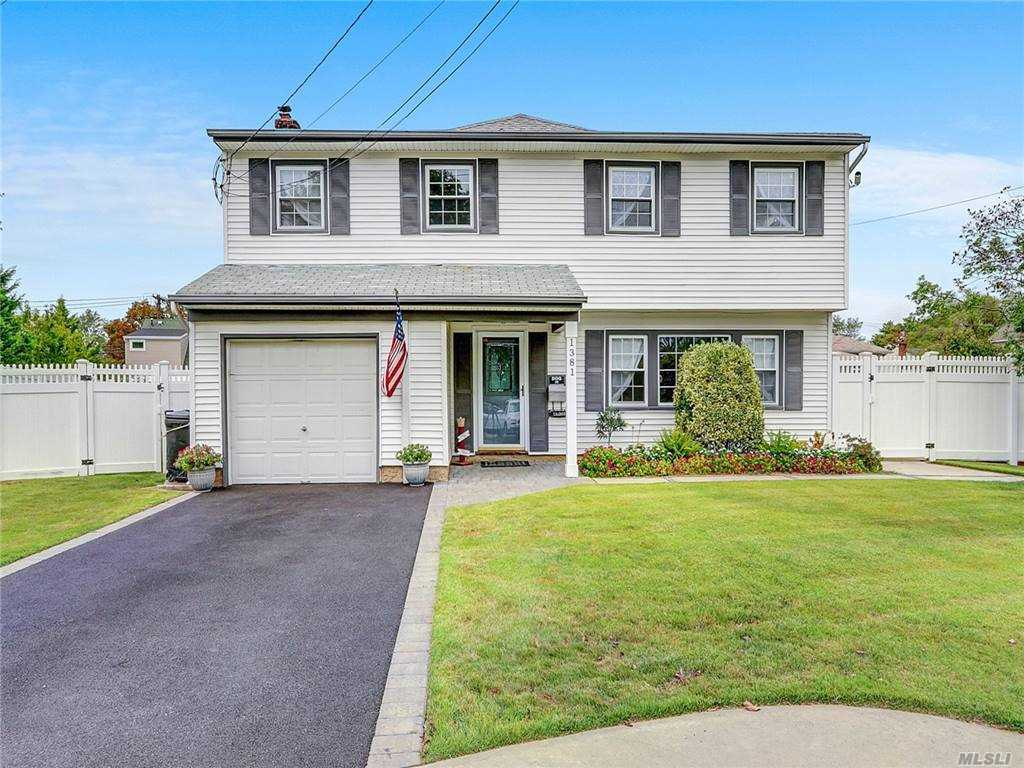Introducing this Wonderful Expansive Colonial with 8040 lot sqft area having two separate yards ..This beautiful spacious house features 14 Rooms with 2 Living Rooms (one with electric Fireplace) ,2 Dining Rooms,Eat in Kitchen ,Full Bath plus One Room/office on the First Floor..5 Bedrooms , Master Suit with walk in closets , 1.5  Brand New updated Bathrooms and an Open Room/Library Space available on the 2nd Floor..1/2 Partially Finished Basemnt.Guest Quarte, ,Updated 10 Year aged New Roof ,Ceiling Fans & Overhead Lighting, Hardwood & Vinyl ,plenty of storage space available all over the house  ,Freshly Painted,  Updated Windows, 200 Amp Electric, Oil Heating, 2 Washer/ Dryers, Blacktop Driveway w/Paver Trim & Walkway, Cement  Patio, Fantastic Taxes! Close to all amenities .. ALL FINISHED ! READY TO MOVE IN !  MUST SEE..