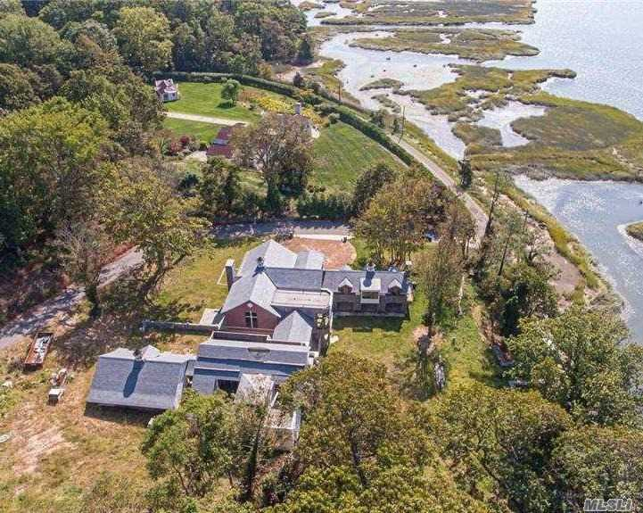 4.1 acres with stunning views of the Nissequoge River and just steps away from beautiful beaches and the Long Island Sound.   This 11,000 square foot home is still under construction.  The exterior is mostly complete with New Brick and Custom Stonework, New Windows, Slate Roof, and Multiple Terraces. The interior features a layout of 7 Bedrooms, a Huge Grand Room, 5 Full Baths, 2 Half Baths, a Theater Room, Bar, Gym, and 3 fireplaces. The Interior is currently framed out and needs completion.  Finish your kitchen, baths, master suite, and bedrooms exactly how you want your dream home to be. Taxes are subject to change.