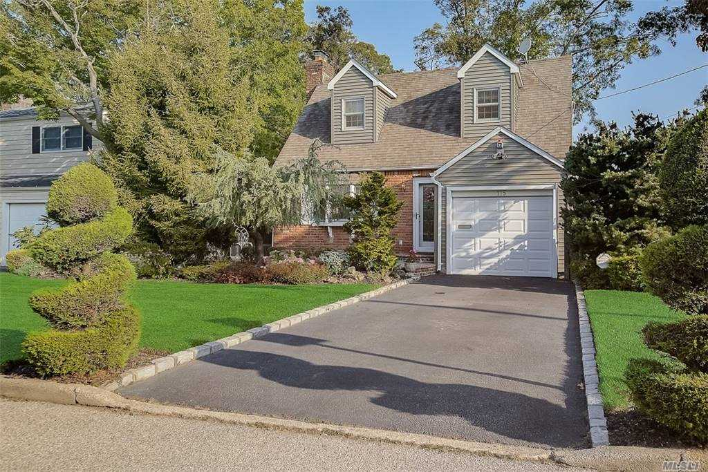 One of a kind expanded Cape. Gleaming hardwood floors throughout. Fully finished lower level with walkout to oversized deck. Be awed by the private and serene setting. The views from the upper level is the nature lovers' dream. New roof, Andersen windows, updated electric, and heating/cooling system. Near shops, restaurants, and the LIRR