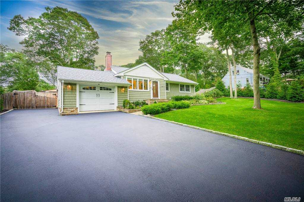 Pride of Ownership Shines Throughout this Immaculate 3 Bedroom Ranch Located in Hampton Bays! A Beautifully Updated Kitchen is Just the Start to the Tasteful Renovations this Home has Recently Received. This Inviting Space Built with Quality Craftsmanship and Attention to Detail Will Welcome You Home! The Picturesque Landscaped Property is Tranquil and Serene! A Backyard Designed to Help You Unwind and Relax! Other Amenities Include Wood Floors Throughout, Fireplace, Central Air Conditioning, In Ground Sprinklers, Full Finished Basement with Outside Entrance, Heated and Cooled Attached Garage, Additional Detached Garage and Carport! Centrally Located to Beach and Peconic Bay! Taxes with STAR $5,275!