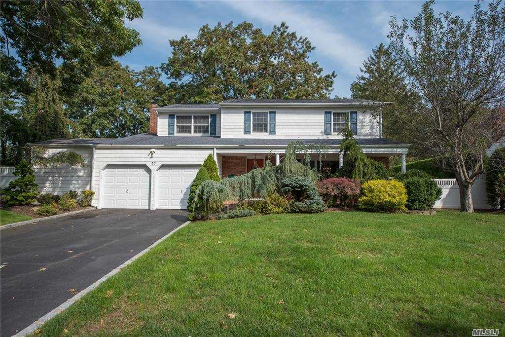 Do not miss this mid-block, picturesque colonial located in the blue ribbon Commack Schools! The home boasts hard wood floors, (including under carpet in bedrooms) a gorgeous wood burning fireplace, updated kitchen and a country club yard with IGP! Upstairs, the four bedrooms are all nice sized, and are off of a spacious foyer. Basement is full, partially finished with plenty of room for storage. The large trex deck surrounding the pool is maintenance free and amazing for entertaining. Brand new CAC!