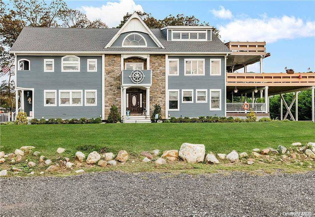 This nautically-inspired home on the South Shore of Long Island on the Great South Bay offers the exciting lifestyle you're seeking! This beach house has it all. Brazilian Cherry hardwood throughout is warm and inviting. From fire pits to beer and wine fridges, radiant-heated floors, large screen TV's and Sonos sound system both in and out, you'll enjoy many years entertaining or just relaxing in the huge chef's kitchen or adjoining family room. With 5500 sf, everyone can have their own work or learning space with ease. Adjoining guest quarters could become a parent's private unit or used as an additional office area. The design is smart, elegant and provides too many amenities to list. You won't find another home like this in this price point. The Great South Bay and Fire Island are a short 15 minute ride by boat or ferry. Take your golf cart to the Tiki Bar at Sunset Marina and stroll back to watch the stunning sunset. Don't let this one get away!