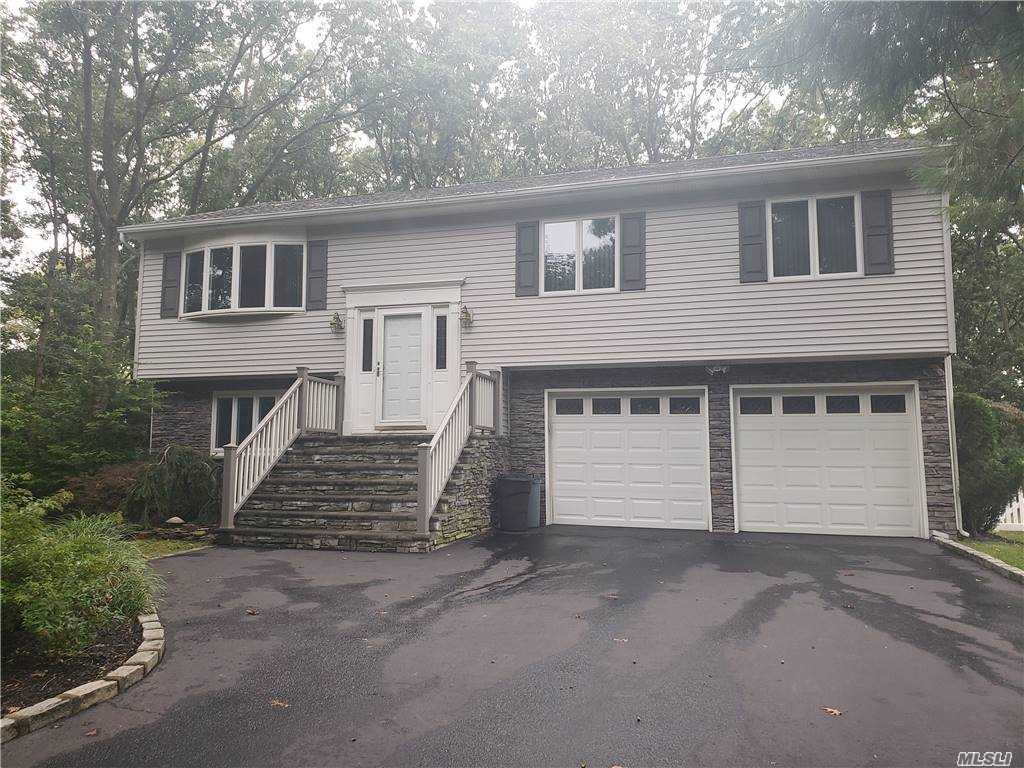 This Charming Hi Ranch sits on a Cul De Sac,  Smithtown Pines taxes, Hauppauge Schools, close to all, parklike fenced in property.   Features 4 bedrooms, 2 full baths, hardwood floors under carpeting, living room, dining, room, Eat in kitchen, deck over looking spacious yard, 2 car garage, above ground oil tank, generator plug ready, 150 amp electrical service.  Roof, siding, stone work, deck and oil burner approx. 7 years old, Move right in!!!!