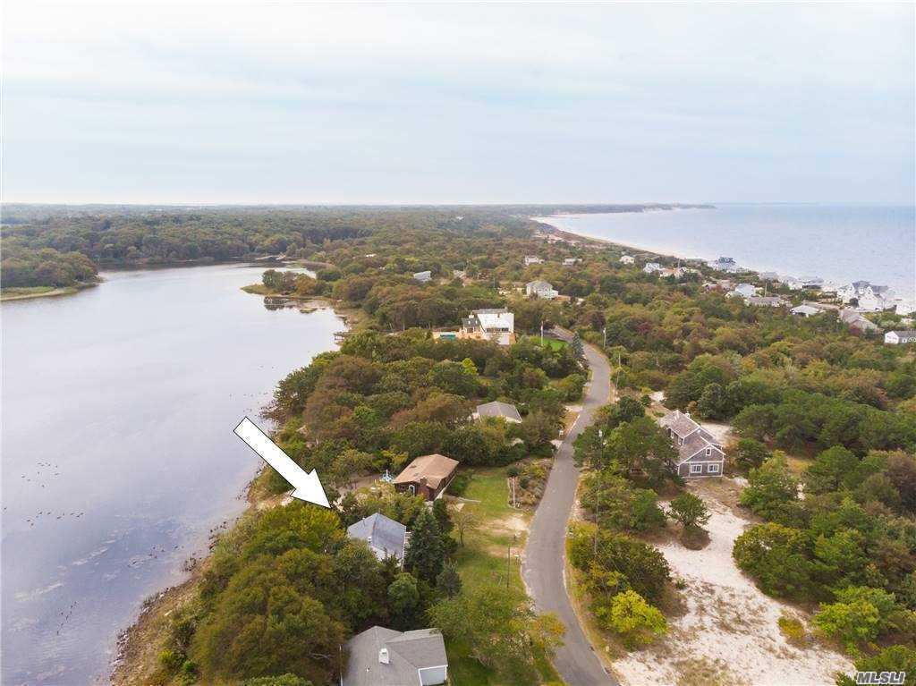 NEW TO THE MARKET.  Enjoy Sunrise and sunsets from this waterfront charmer on the Great Pond - Southold's fresh water lake.  Go fishing, swimming, kayaking, boating, and even ice-sailing in the winter!  LI sound beach just steps away.    Walk for miles on the beach. Renovated, light and bright, large great room, eat-in-kitchen with sliders to the deck and water views of the lake.  two bedrooms, bath.  Basement for storage.