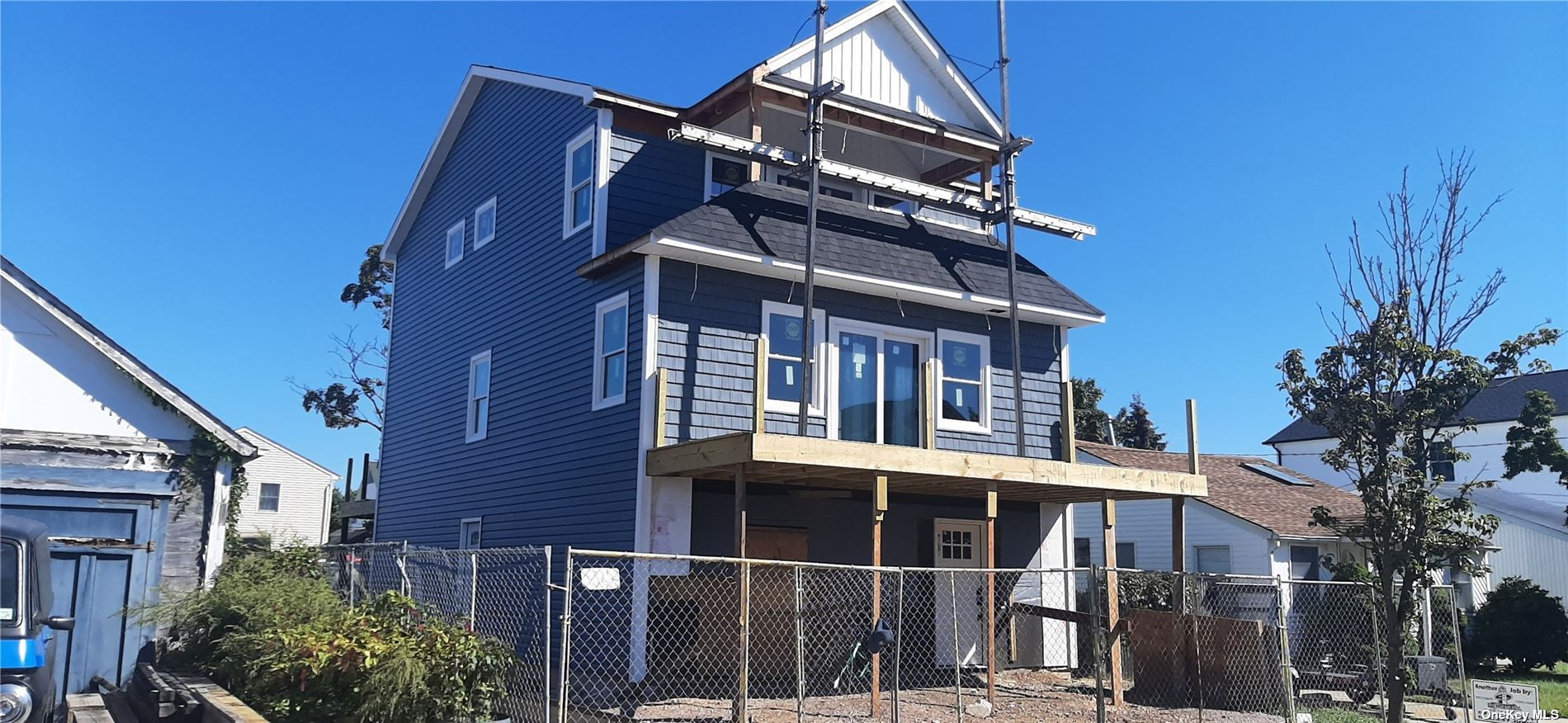 ***Still Under Construction*** Practically brand new FEMA compliant(low flood)!! 2 story with lower Garage level. Complete gut renovation. New Plumbing/Electric. Open concept with hardwood floors. Stone counters SS appliances. 3 Decks. Canal Water View!!