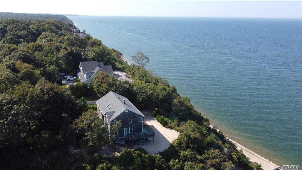 Gated Scott's Beach Waterfront 5 BR Diamond Colonial On A Secluded Quiet Cul-De-Sac In The Desirable Private Scott's Beach Community W/panoramic Views Of The L.I. Sound. Master Bed With En Suite, WIC, and Observation Balcony, 3.5 Baths,CAC Hwd Throughout, Granite, Stainless, Dual LR/DR Fpl, Wet Bar, Newer Roof, Walkout Finished Basement W/In-Law Suite W/Wet Bar, 2 Car Gar .Waterfront Home In A Private Setting Bordering Town Property & Open Space. See The Virtual Tour.