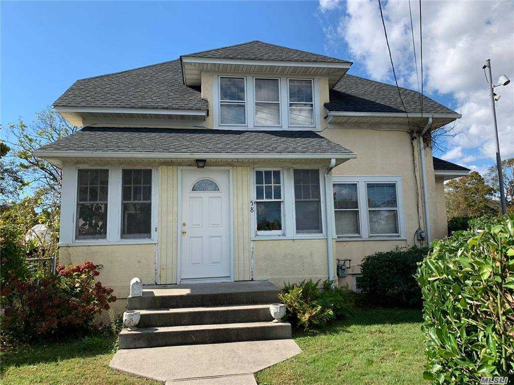 Charming Cape w/1,310 Square Feet in Need of TLC.1st Floor has 764 SF & Features Enclosed Porch w/128 SF, Living Room, Dining Room, Eat-in-Kitchen, Den & 1/2 Bath. 2nd Floor has 546 SF & Features 3 Bedrooms & Full Bath. Full Basement w/Boiler & Laundry Area. Detached Garage w/240 SF. Large 50' x 299' Property. Low Low Taxes. Walk to LIRR & Bay Shore Main Street Restaurants & Stores.