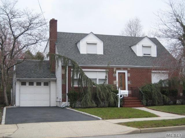 Nicely Maintained Wide Line Cape With 1/2 Dormered Second Floor And Attached 1 Car Garage, 60 X 100 Property, Featuring 4 Bedrooms, 2 Full Baths, Hardwood Floors On The 1st Floor, Eat In Kitchen W/ Access To Backyard, Second Floor Has Rear Dormer With Great Bedroom Sizes, 1 Full Bath, Sitting Area, Lots Of Storage Throughout The House And A Full Basement Offering Tons Of Additional Space For Storage/ Play Area.
