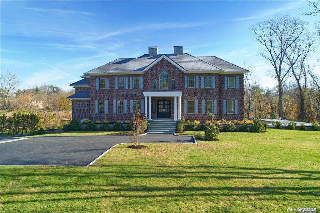 Brand new construction 6 bedroom brick colonial located in prestigious Kings Point, NY. Privately secluded on Split Rock Drive, this magnificent new residence offers all of the latest amenities most desire. Dramatic 2 story entry foyer with imported marble floors, custom millwork throughout the entire residence, formal living rm with coffered designed ceilings, many windows allowing light to enter and showcase the space and stunning wood floors, family rm with fplc adjacent to the gourmet EIK with separate breakfast rm, both having access out to the private yard, patios and in ground pool. A butlers pantry ideal when entertaining in the formal dining rm,home office with custom built-ins, and a 1st floor bedroom and full bath located near the side entrance and laundry room.The primary en suite is privately situated on its own side of the residence with enough space for its own living room, bathroom w/soaking tub and jet shower and separate bonus room. Elevator, radiant heat,pvt drive