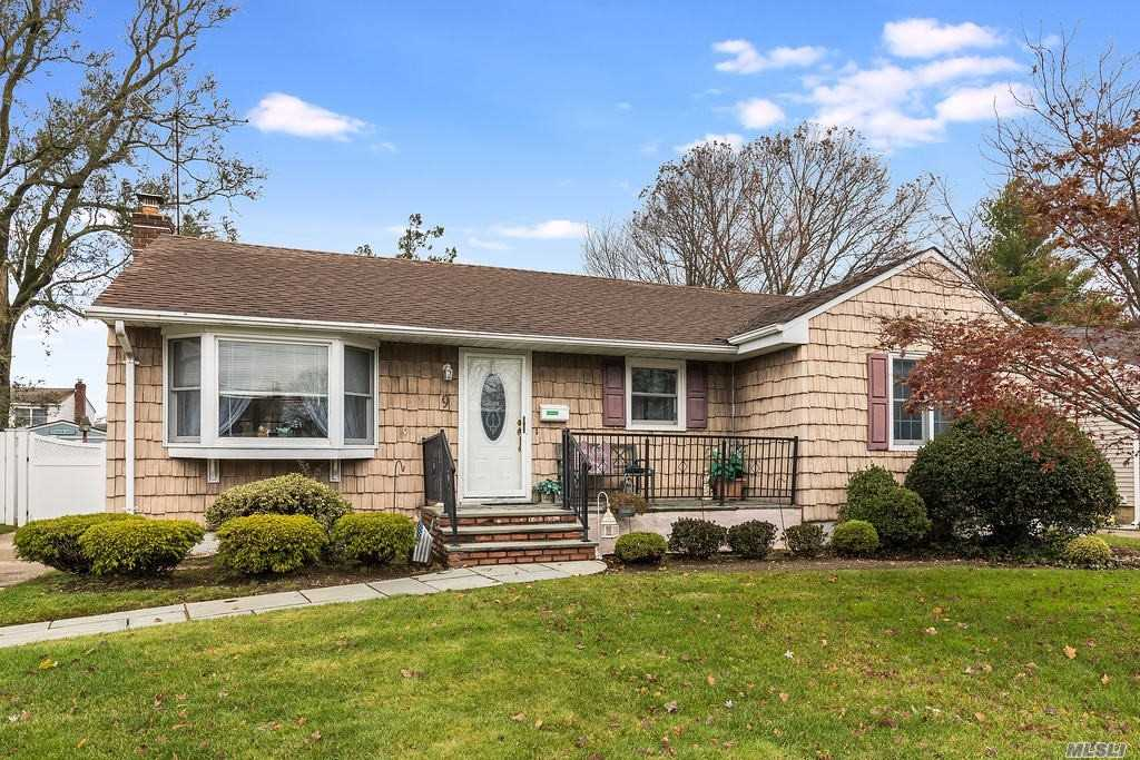 Lovely Sunny Ranch Features Bluestone Walkway and Front Porch, Updated EIK Corian Counters, Baths, Roof and Furnace. New CAC, Hot Water Heater, Gleaming HW Floors, Entire Home Recently Fully Insulated with Foam/Blown in.  PVC Fence.  Patio & Separate Screen/Sunporch OS Yard, 1.5 Detached Garage. Gas on Street. Convenient to all. Just Move Right Into This Sparkling Home