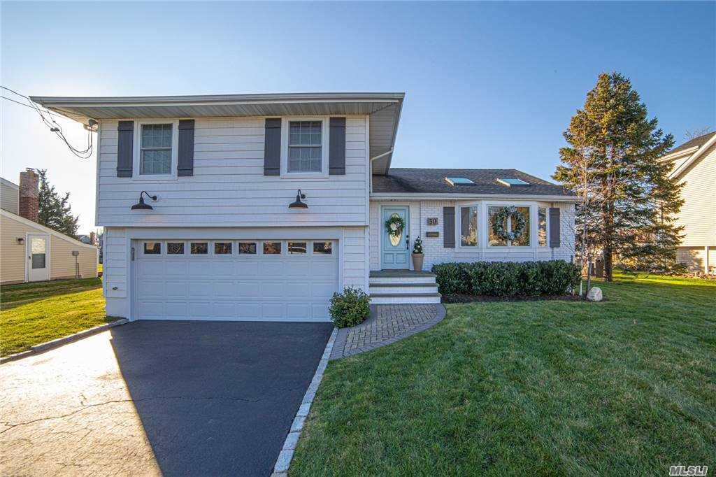 Pristine 3 Bedroom, 2.5 Bath Home Located On The Canal. Open Floor Concept On Main Level. Eat-In-Kitchen Flows Directly Into Outdoor Deck With Pool That Overlooks Canal.