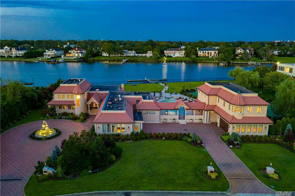 One Of A Kind Waterfront Estate!!!  A Lifestyle That Can't Be Imagined - Situated on 2.0 Manicured Professionally Landscaped Acres With 300' Of Direct Water Access With Dock, In-Ground Gunite Saltwater Pool, Tennis/Sport Court, Outdoor Kitchen, Firepit And Multiple Patio Spaces For Entertaining. No Detail Has Been Overlooked In This Outstanding Residence. A Custom Designed Layout Offers Sunlit Principal Rooms With Panoramic Views, 7 Bedrooms, 7.5 Baths, A Guest House & Open Concept Living For Today's Work At Home Environment.
