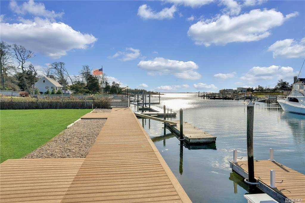 Waterfront cottage sitting on deep water canal for large boats.  Adorable open floor plan cottage with amazing bay views or build your own home on the water.  An amazing opportunity for those who want a waterfront home.