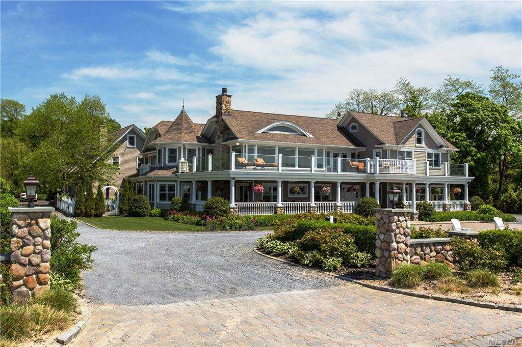 This Stunning Waterfront Estate sits privately on 2+ acres of perfectly manicured lawns with unobstructed views of the NYC Skyline. This captivating home features a grand two story foyer,  Spacious Living and Family rooms, an elegantly designed dining room with access to outdoor entertaining spaces. An expansive, state-of-the-art kitchen features high end appliances, an oversized island with seating and an eat in kitchen and abundant pantry space. The main level also boasts an impressive office, wet bar and bedroom.A grand staircase leads to an awe-inspiring master suite with  exceptional city skyline view. Which also features a deluxe master bath, walk in closet and sitting area. . This level also features an additional 5 bedrooms with en-suite baths. A lower level basement is fully finished it's own indoor hockey rink, state of the art fitness center, yoga studio and entertainment room &  separate indoor basketball court. Two acres of sprawling lawns are showcase an IG gunite pool
