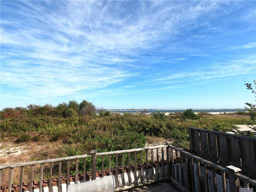 *Jones Inlet Waterfront Beach Estate on a *Rare Valuable Double Waterfront Lots, 6,000 sq ft, 80' x 75' total Lot, Lots #117 thru #120, *Great Views, Traditional Brick Cape surrounded by Brick Walls, 6 Bedrooms, 2.5 Baths, Living room w/Fire Place, Eat in Kitchen, Wood Floors, Screened Patio, Waterfront Sun deck, garage w/Cabana plus 5 car parking, Large grounds, room for a Pool, *Great Opportunity with the *Only Property Available on Jones Inlet in Point Lookout, 45 mins NYC, *Great Location *Great Investment.