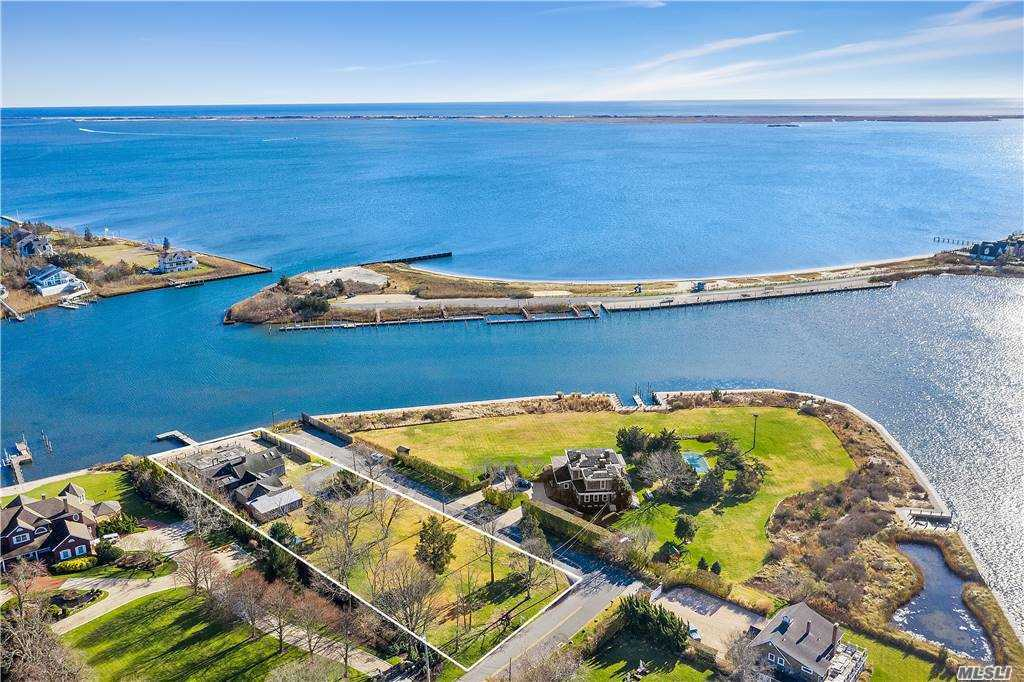 Build your dream home on this bay protected land. There is approximately 100 ft of bulkhead, a dock already in place, large deck and an in-ground pool.  Here you can enjoy the water and beautiful views.  All you need to do is make it your own oasis.