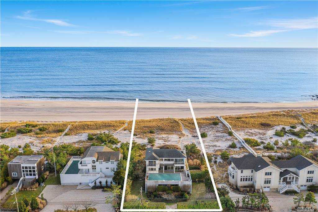 Tucked in the dunes with natural barriers, sits 599 Dune Rd. Featuring the best both the bay & the ocean have to offer. Windows on all sides and sliding glass walls allow for maximum viewing. Take in the sunrise over the ocean or the stunning sunsets over the bay.  Enjoy the 100 ft ocean frontage, lounge in the massive gunite pool on the bayside, or down to your bay dock for a sail. Built in speakers encourage entertaining, as does the open flow of the dining room & living area. The kitchen gazes out over the bay & comes complete with subzero appliances, marble counters, & white cabinetry for a clean, timeless look. Marble features throughout in each of the three bathrooms. An imported French marble hearth adds an extra element of class to this already stunning home. Hand-carved woodwork enhances the unique nature of the home as a whole. Master suite with water views, plus a second fireplace for those cool evenings. Central air throughout ensures that you'll be comfortable year round