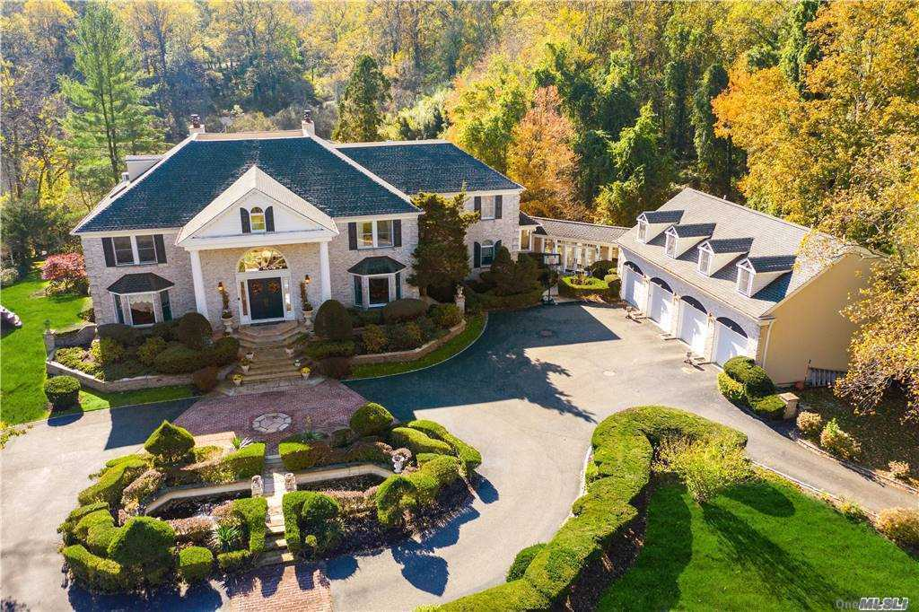 Drive thru Steel gates to magnificent 9+ Acre, 18 room Estate/retreat/ in Centerport on a pond. Serene and private.  Enter grand foyer/polished marble floors/bridal staircase,  Home Office/Library,, 3 fireplaces (Living room, family room, Master BR).Indoor hot tub o'looks pool/pond.  lower level gym.  Gourmet granite/stainless kitchen, multi-level decks, IG gunite pool, Pond has dock second floor Master suite w/balcony o'looking pool and pond, 3 ensuite bedrooms, third-floor media room/storage, steps to roof deck.  Lower level Gym, media space,4 car garage, 3 br.2bth guest suite above *check attachments for full description*