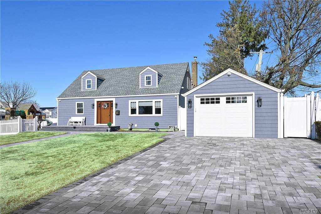 Meticulous Very Well Maintained Cape Located In West Hempstead w/ Franklin Square SD!  Updated Roof, Windows, Siding, Garage Door, Gas Burner, SS Appliances, Newer Limestone Pavers! 3 Zone Sprinklers, Gas Line For BBQ, Security System, Detached Garage.  Don't Miss This One!