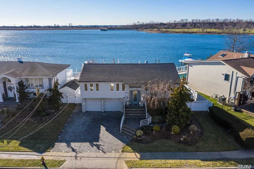 Welcome home to this boaters paradise on the open bay w/ 2 boat slips.  West facing backyard for a sun-filled afternoon and majestic sunsets. House was fully renovated in 2016. Radiant heated floors throughout.  Light, bright, and airy open concept floor plan.