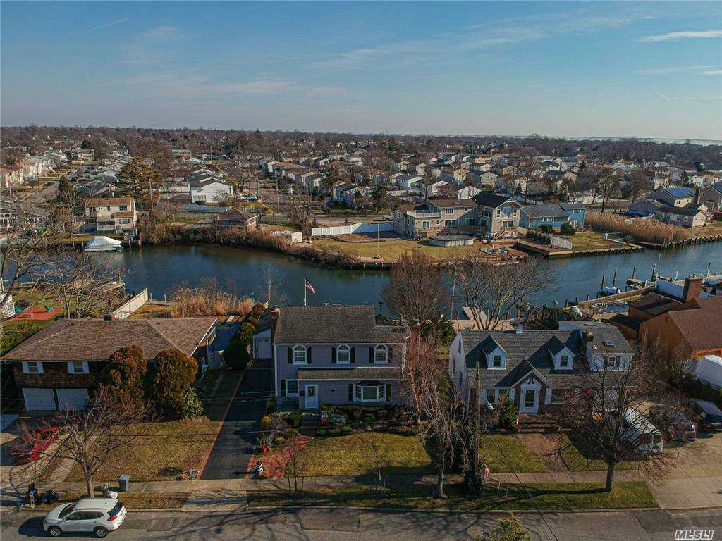 Welcome home to waterfront living on the Carman River. This beautiful Colonial is nestled in Nassau Shores in Massapequa. This home features 3 bedrooms,2 bathrooms,Living room with a gas fireplace, eat in kitchen with heated floors, den/family room with a wood burning fireplace that includes access to an outdoor hot tub. Hard wood floors as seen, Veranda deck off of the kitchen overlooking the river. 60 feet of bulkhead and a Sun room to enjoy a beautiful sunset. 12 month Home Warranty available.