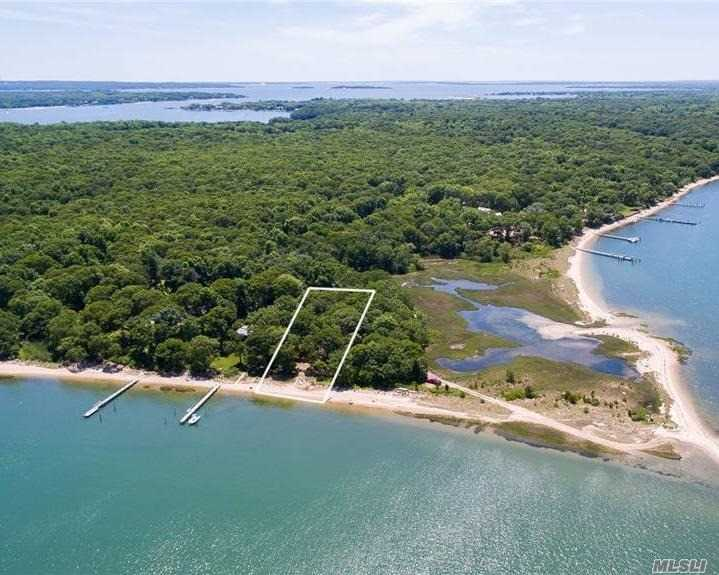 With a breathtaking view east for sunrises towards Taylor's Island and sunsets to the west through the trees, this amazing property won't last. The tranquility of Coecles Harbor and the remote location surrounds you with amazing wildlife. Make this unique property your own. Come to Shelter Island, there are many means of transportation to bring you here to enjoy the beauty our island offers.
