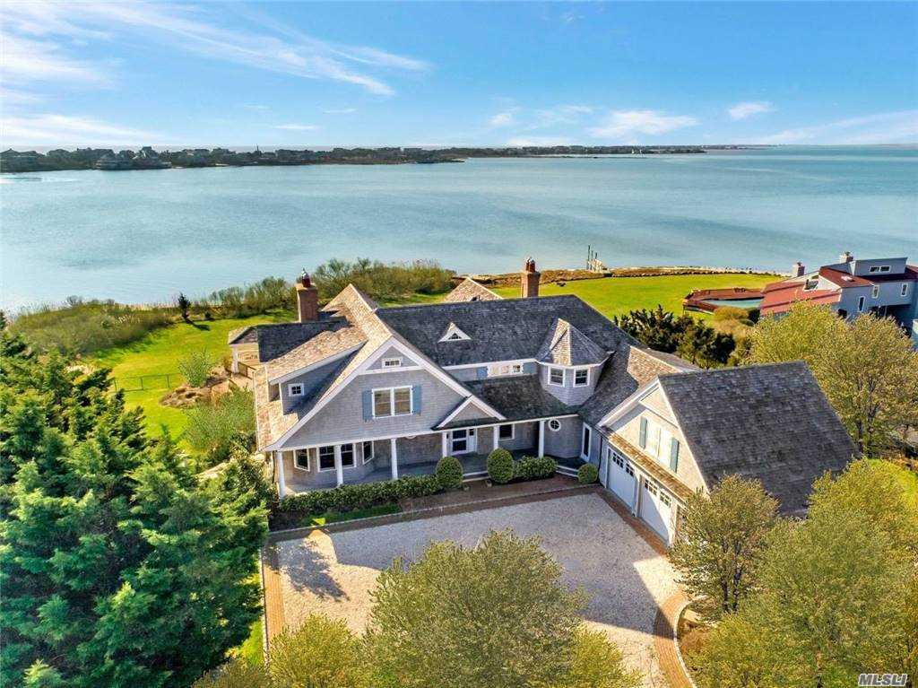 Built in 2007 on 1.25 acres, this custom, 6785sq.ft. bay front home in Westhampton Beach encompasses 5 bedrooms and 5.5 baths, and a bonus room above a 3-car garage. The first floor features 1.5 baths, a guest room, laundry room, living room, and an open floor plan with family room, kitchen, and dining area. The chef's kitchen features granite counter tops and top of the line appliances. Upstairs there are four bedrooms and 4 bathrooms. The master suite and two guest bedrooms have sun porches and beautiful bay views. The master bathroom includes a steam shower, jacuzzi, and radiant heat flooring. Outside you will find unparalleled water views as far as the eye can see. The centerpiece is a heated saltwater pool and Jacuzzi surrounded by brick pavers. A boat dock provides bay front access for a 28-ft boat. Throughout the property there is lush landscaping and perennial gardens. Minutes from ocean beaches and the heart of the Village.